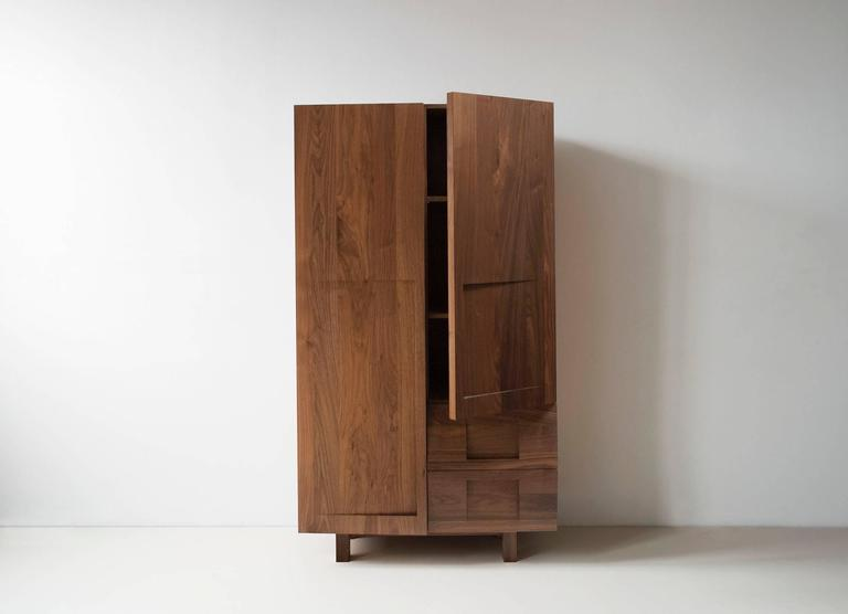 The wardrobe is one part closet, one part dresser and one part