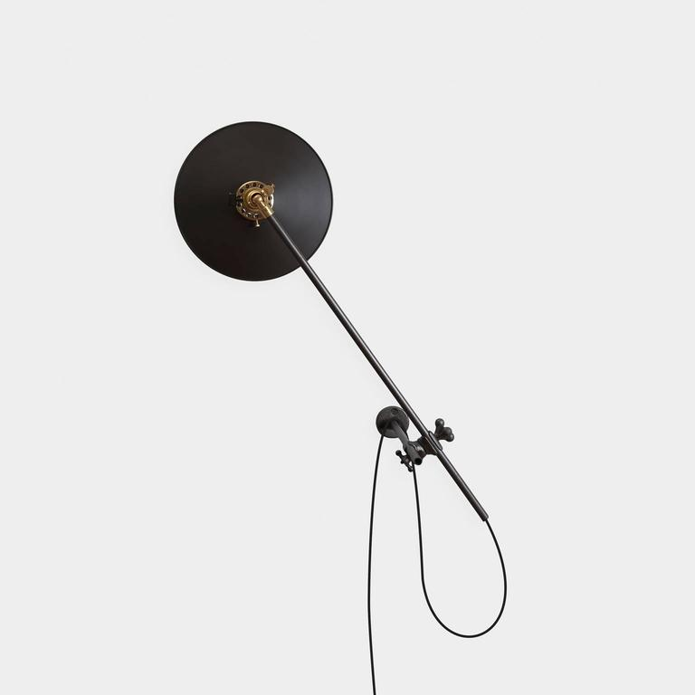 The Industrial wall lamp is a simple yet highly flexible fixture. It can be utilized as a wall sconce, reading lamp, ceiling washer, or even task light. Complemented by a black steel shade, the lamp is an elegant and flexible frame for a single
