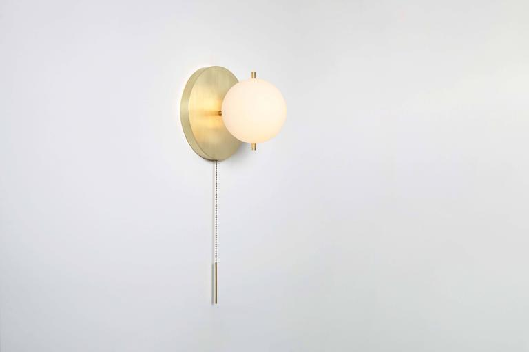 Modern Workstead Signal Sconce in Brass with Blown Glass Globe and Brass Pull Chain For Sale