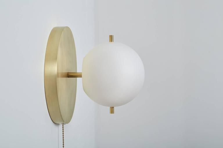 American Workstead Signal Sconce in Brass with Blown Glass Globe and Brass Pull Chain For Sale