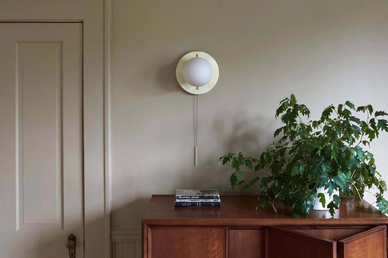 Contemporary Workstead Signal Sconce in Brass with Blown Glass Globe and Brass Pull Chain For Sale