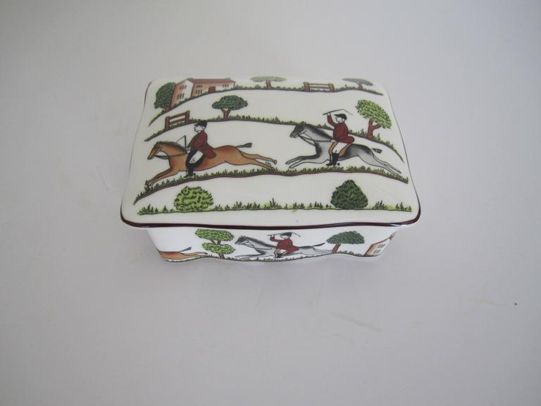 An equestrian horse 'hunting scene' box in fine bone china called 'the chase', in the style of Hermès. Box is from England, with marker's mark (Crown Staffordshire), as show in image #6. Hues include emerald green, light green, browns, grays, black
