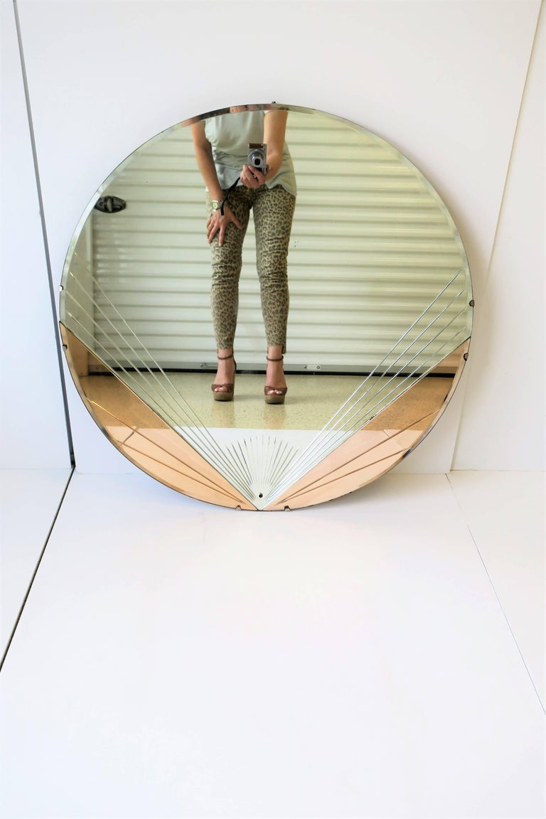 A Very Beautiful Round Art Deco Period Wall Mirror With Pink Or Rose Gold Colored Mirrored