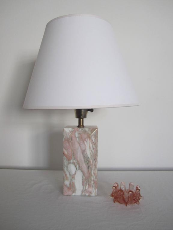 A chic, beautiful, and substantial '70s Modern or Post Modern period marble table or desk lamp, circa 1970s. Marble is polished, rectangular in shape, and has an 'emerald cut' detail on front and back. Marble has shades of white, pink, grey, and a