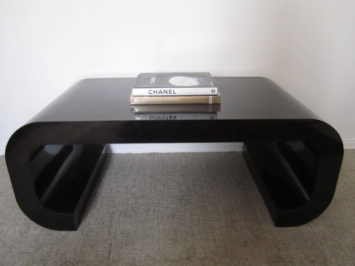 vintage modern black scroll coffee table in the style of