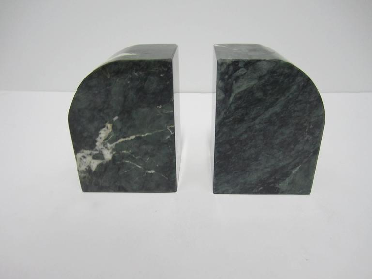 A substantial pair of '70s Italian Modern or Postmodern dark green and white marble bookends. Carved and polished, circa 1970s, Italy.   Each measure 5 in. H
