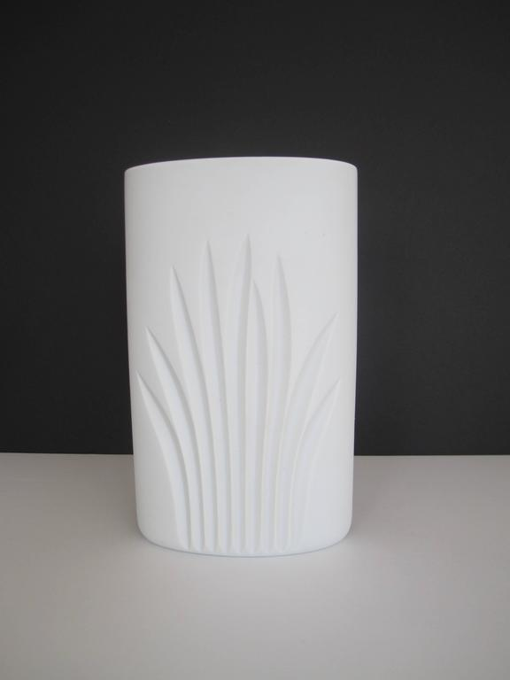A vintage white matte porcelain ceramic pottery vase by Rosenthal Studio-Line Collection, Germany. Oval in shape with identical organic design on both sides. Maker's mark and unique number on bottom of vase as show in image. Vase is 9.25 inches