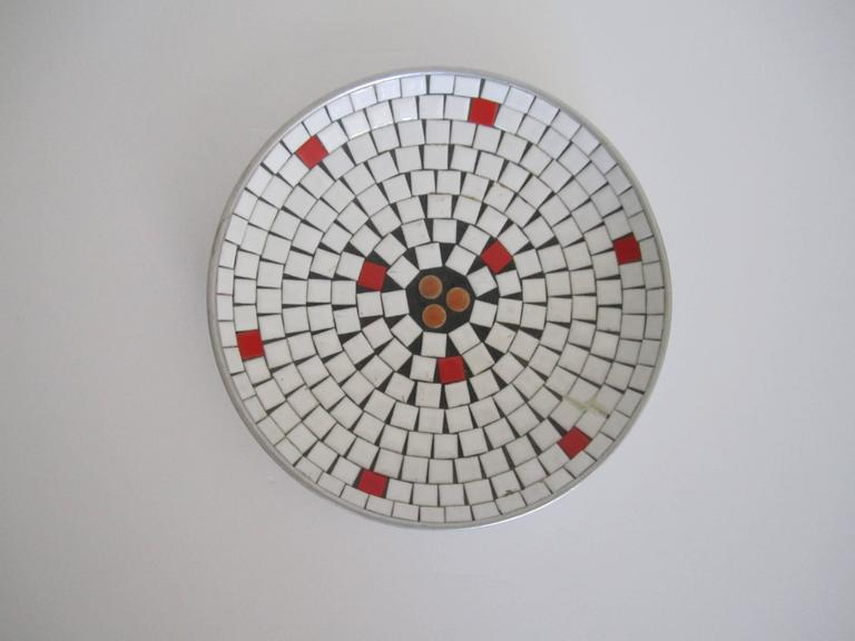 A very beautiful Mid-Century Modern white mosaic ceramic tile dish or bowl, circa 1960s. Bowl is made of predominantly white tiles, with touches of red and orange; nine red around and three round orange tiles in center.   Measuring: 7.5