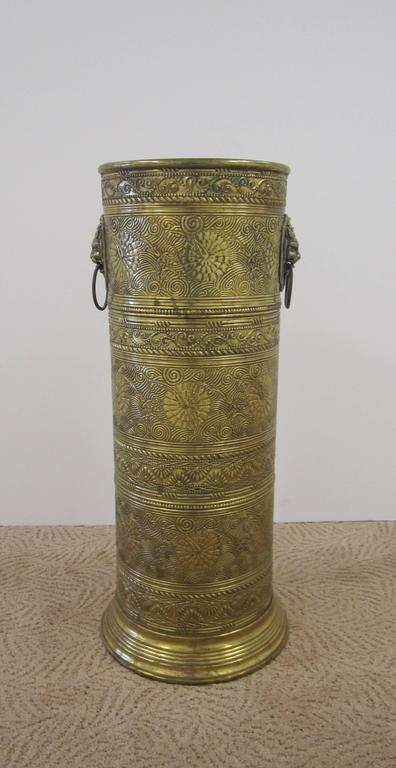 Vintage Brass Umbrella Stand With Decorative Lion Heads At