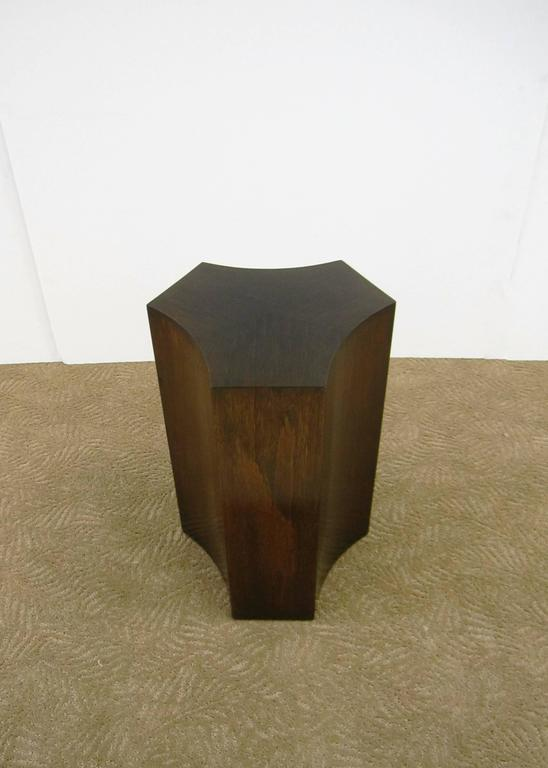 A beautiful quality and elegantly designed vintage warm wood pedestal side table in geometric form.   Table measures: 19 in. H x 10.5 in. W x 10.5 in. D.   Item available here online. By request, item can be made available by appointment to the