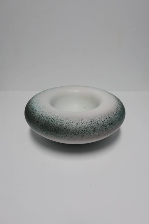 A substantial Post-Modern signed Italian ceramic pottery bowl. Colors include, off-white to a very light grey, with black, blue and green speckled or 'shagreen' like design. With maker's mark and marked 'Made in Italy' underneath as show in image.