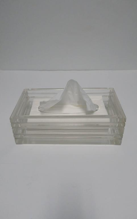 A beautiful and substantial vintage Modern Lucite tissue box in the style of American Designer, Charles Hollis Jones, circa 1970s or later. Substantial Lucite with horizontal indentation detail on all sides.