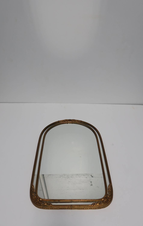 Antique brass wall mirror