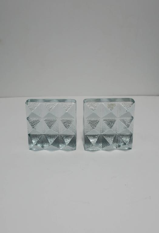 A pair of solid glass textured 'pyramid' stud bookends. Glass is clear with a hint of an ice blue hue.
