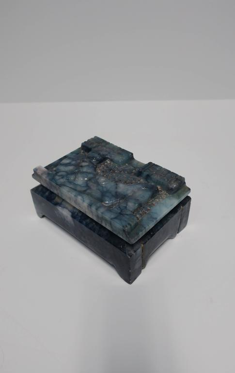A unique, beautiful, and substantial vintage blue and white carved marble hinged decorative box or jewelry box. Carving design on top depicts an ancient relief. Box may be European or Asia/Middle East, circa 1960-1970s.  Box measures: 3.25