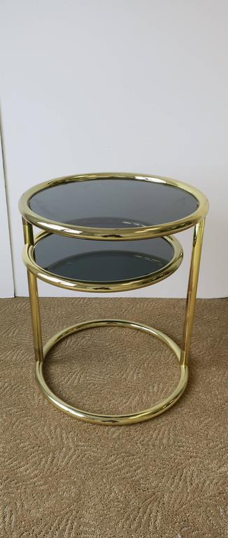 A U002770s Modern Tubular Brass And Smoked Glass Round Side Table With Swivel  Shelf.