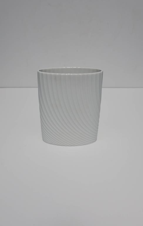 A beautiful white matte porcelain ceramic pottery vase signed by designer on bottom, for Rosenthal 'Studio-Line', Germany. With marker's mark's and designer signature on bottom as show in image #10.   Measurements include: 7 in. H x 5.5 in. W x 2.25