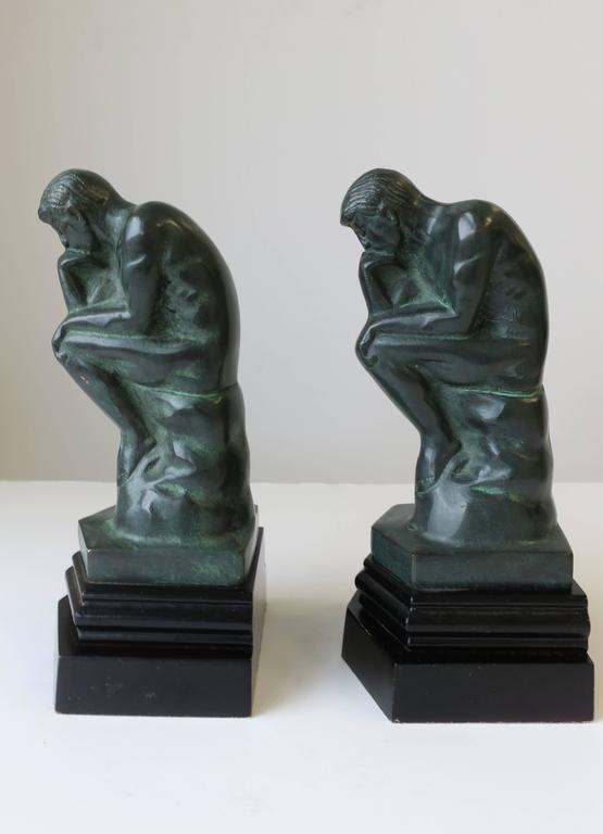 Metal Pair of Black and Green Male Sculpture Bookends For Sale
