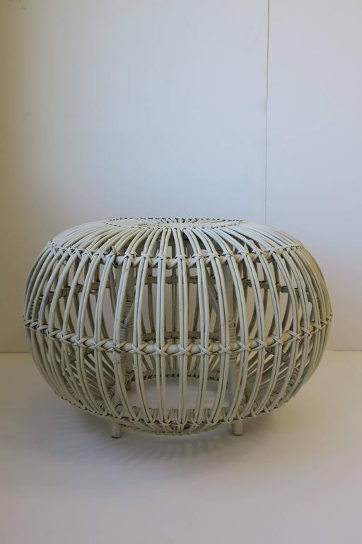 A vintage Mid-Century round white rattan stool or side table by designer Franco Albini. Piece can work as a stool/round bench, footstool, pouf/ottoman, or as a side table providing there is a tray or glass top in place.   Piece measures: 24 in.