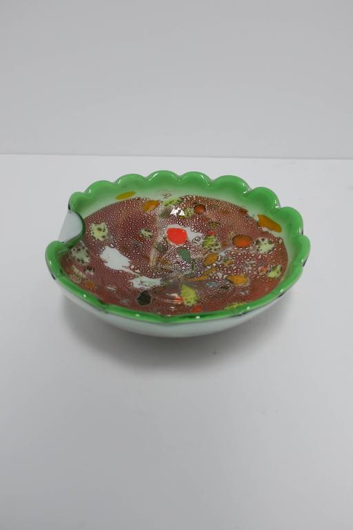 A beautiful Italian Murano art glass bowl in bright green with scalloped edge design. Art glass colors include: bright green, bright orange, white, black, yellow and silver flecks. Bowl is a nice size measuring: 9