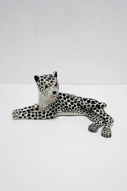 A beautiful, striking, and relatively large vintage Italian Art Deco black and white porcelain cheetah or leopard animal cat sculpture, circa 1970s, Italy. Made in Italy. Marked 'Italy' on bottom as show in image #10.   Measurements include: 5.25