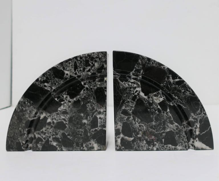 A substantial pair of '70s Modern black and white marble bookends.  Each measure: 6