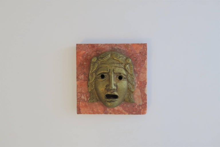 A classical Roman style God or Medusa brass face on orange/red marble base; beautiful decorative object, paperweight, or deck accessory, circa early - Mid-20th century, Italy.   Piece measures: 3.88 in. W x 4 in. D x 1.50 in. H  Item available here