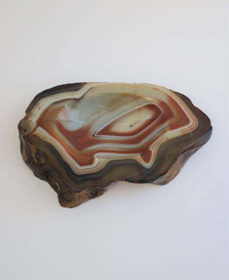 A beautiful vintage decorative agate onyx bowl, dish, or desk vessel in shades of white, off-white and orange. Elegant and convenient for a table, desk, or shelf. Piece can work as a small jewelry dish, a standalone decorative piece, or