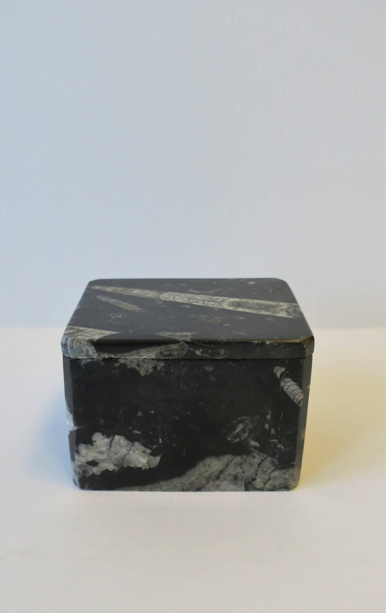Modern style black and white stone jewelry or trinket box. Box has tapered corners and is polished smooth.   Box measures: 4.25
