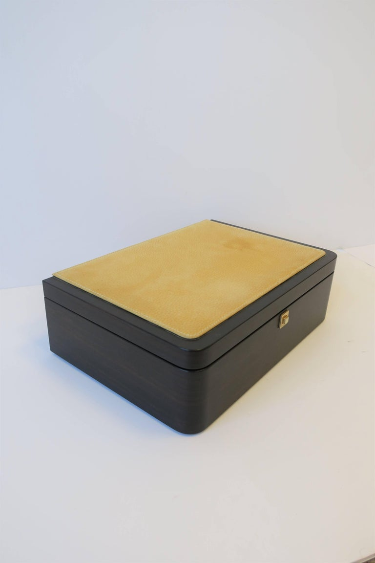 A beautiful Modern style Italian leather and wood jewelry box. Box has wood and yellow leather exterior. Interior is upholstered in a supple butter yellow leather. Box has several compartments including soft pieces to hold watches or bracelets. Box