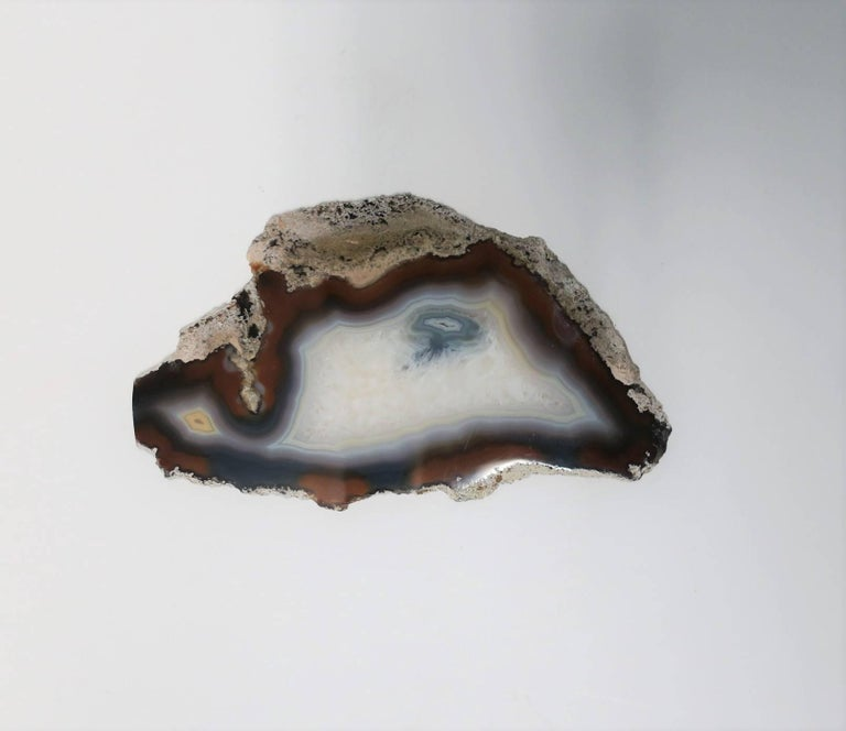 A beautiful blue and white agate onyx decorative object slab or tray. Piece can work well as a standalone decorative object, display piece, or tray to hold small items including jewelry (image #3), perfume, etc. Colors include: white, cream, blue