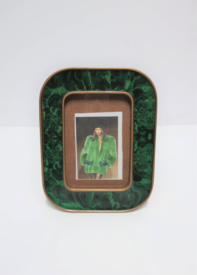 A Modern green malachite lacquer and brass picture frame. Fame can sit vertical or horizontal.   Frame measures: 6.5 in. H x 5.13 in. W (inside photo area is 4.38 in. x 3 in.)