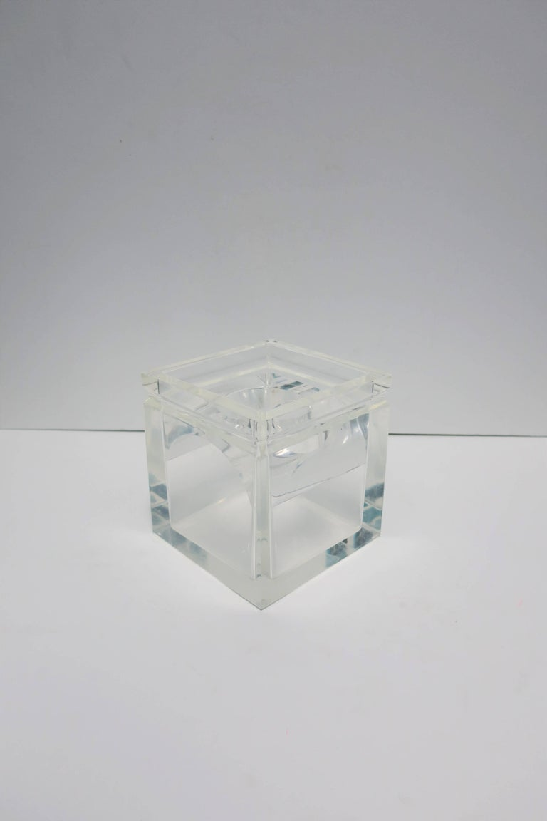 A vintage Lucite tissue box in the style of American designer, Charles Hollis Jones. Box is substantial and made well.