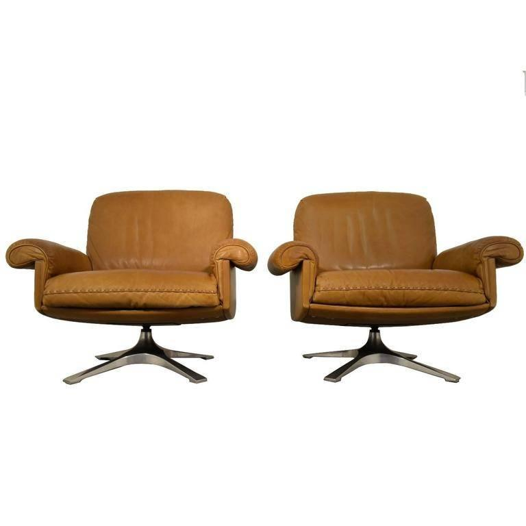 Discounted airfreight for our US and International customers ( from 2 weeks door to door )     We are delighted to bring to you a vintage de Sede DS 31 two-sear sofa and matching pair of lounge swivel club armchairs. This Classic combination was