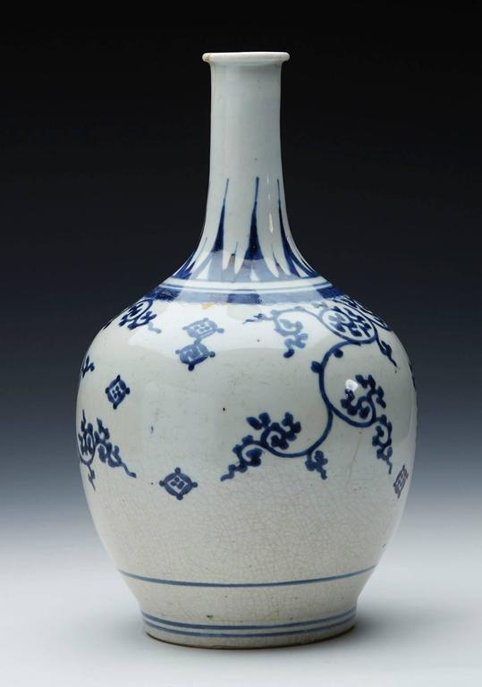 A rare antique Japanese Imari blue and white painted porcelain bottle shaped vase of large baluster shape standing on a narrow rounded unglazed foot. From a Japanese 17th century collection of similar examples all of which have been sold previously