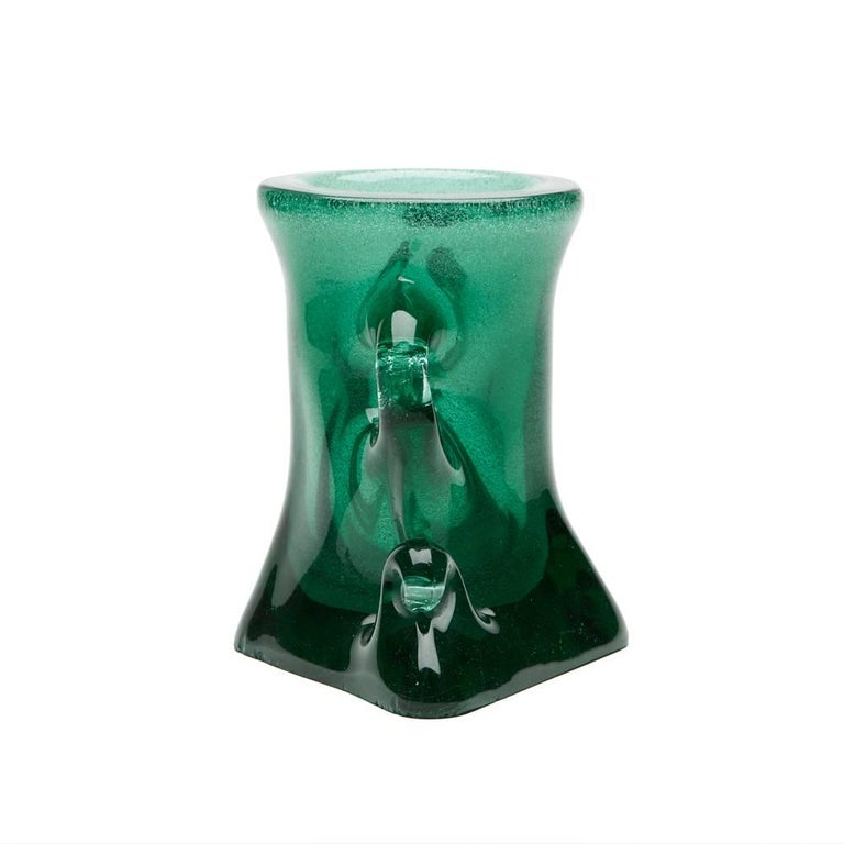 A stylish and unusual vintage Italian, Murano green glass twin handled vase or centrepiece by Archimede Seguso with funnel shaped central vase with looped handles to either side and base pulled to form a diamond shape The vase has a thick heavy