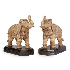 Pair of Vintage Asian Carved Wooden Elephants on Stands