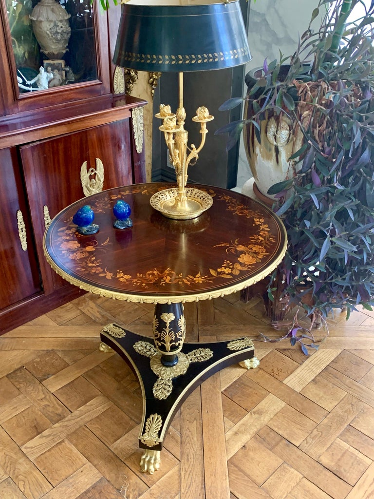 A fine example of Herts Brother's high quality craftsmanship. This round side table is raised on three hairy paw ormolu feet which has a heavily ormolu encrusted platform out of which a column rises to support the finely inlaid top of flower