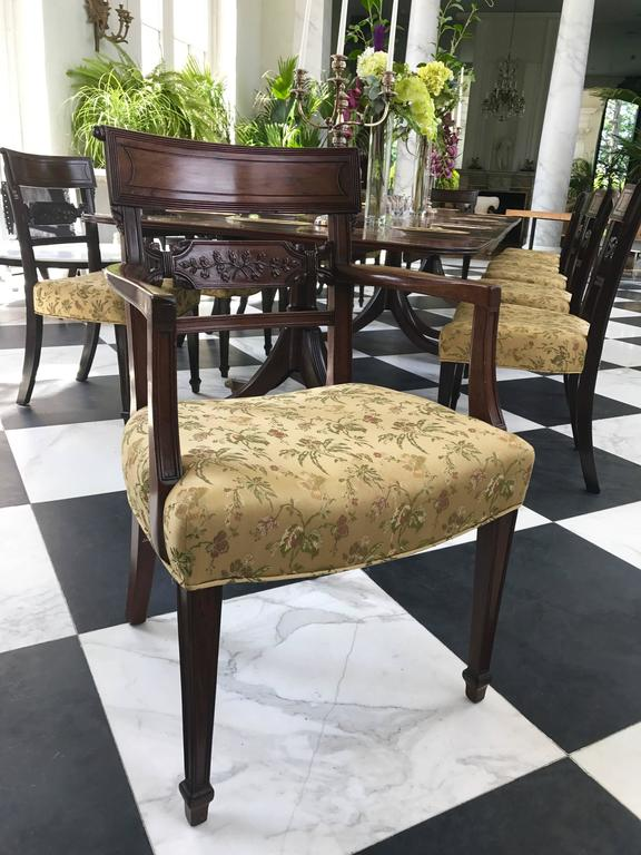 This gorgeous Set of 12 Regency period Dining Chairs has incredibly detailed hand carved backs of foliate design.  They are made of the finest mahogany, Cuban mahogany, deep and rich in color. The legs are tapered with reeding on the edges.  There