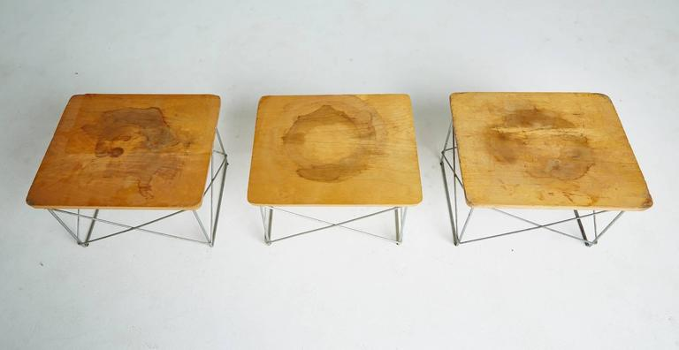 Early 1950s Production LTR tables by Charles Eames, birch table tops over zinc wire frames, marked with George Nelson for Herman Miller labels, a rare but occasionally occurring mixup of labels in the Herman Miller factories. The labels were very