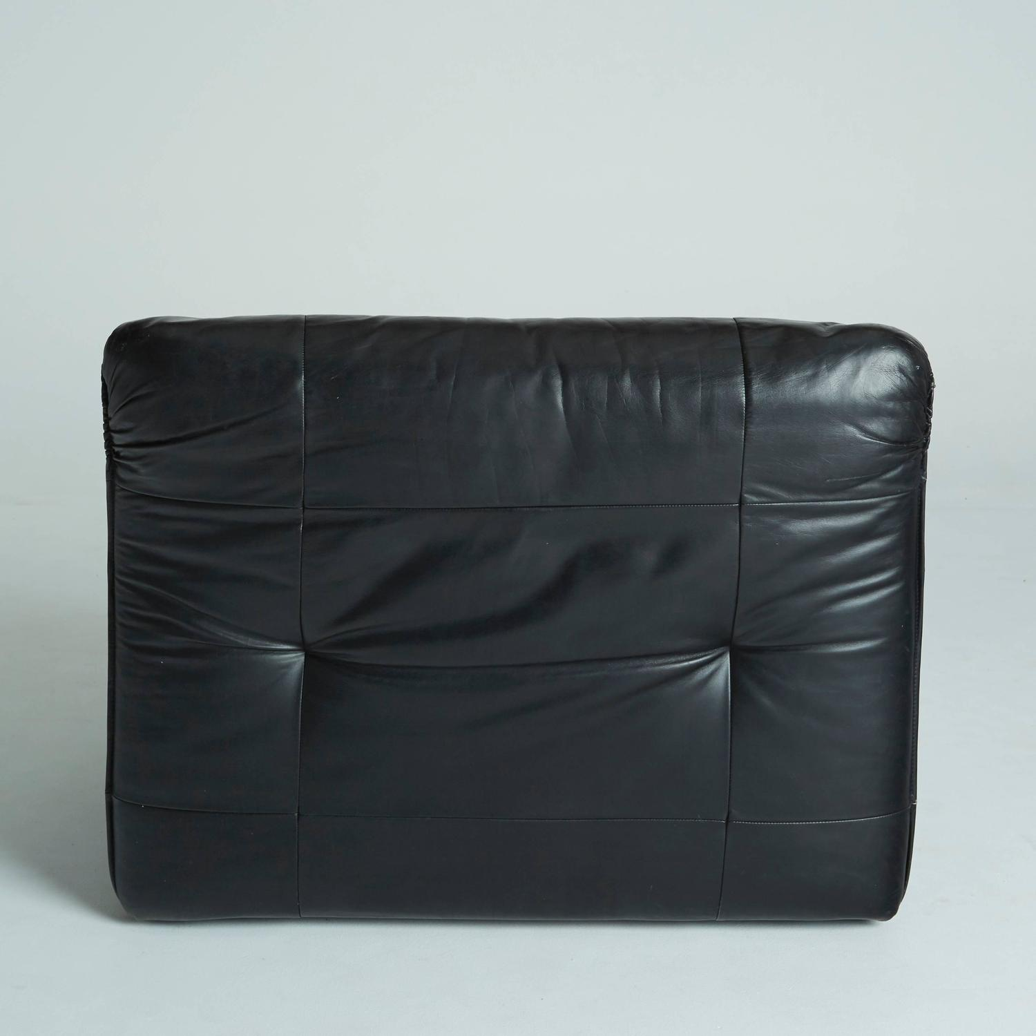pair of black leather club chairs style of vico magistretti for sale