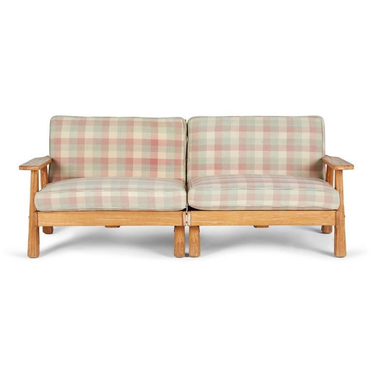 A Brandt Ranch Three Piece Textured Oak Seating Set