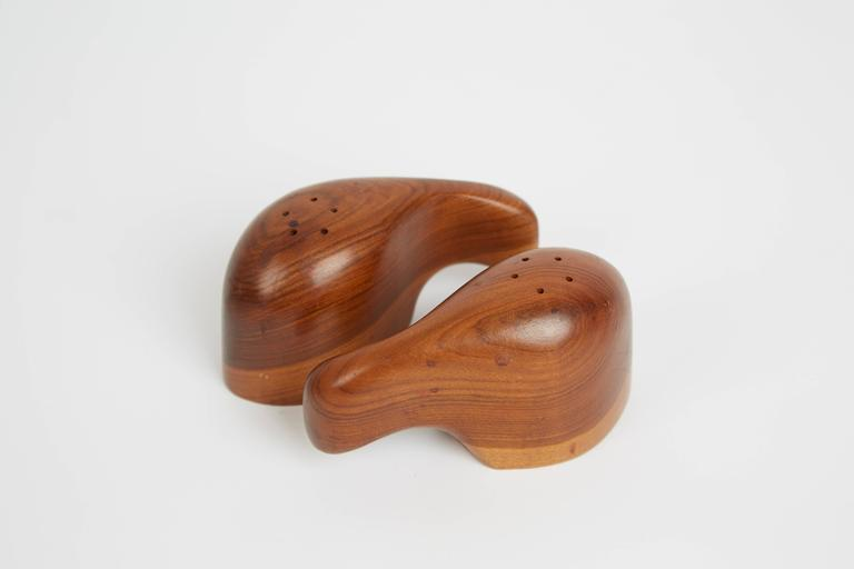 Exquisitely crafted interlocking salt and pepper sets designed by Don Shoemaker for Sen~al of Mexico. Taking advantage of the expertise provided by Mexican artisans, Shoemaker founded Sen~al which produced utilitarian objects, such as these stunning