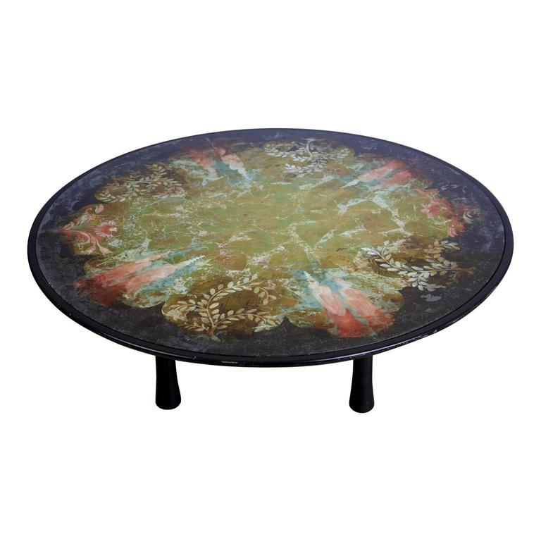 Extensively detailed, large and expansive Scandinavian verre églomisé coffee table supported by sculptural legs. The églomisé design is made applied onto the rear face of glass to produce a mirror finish. This includes an infusion of colors