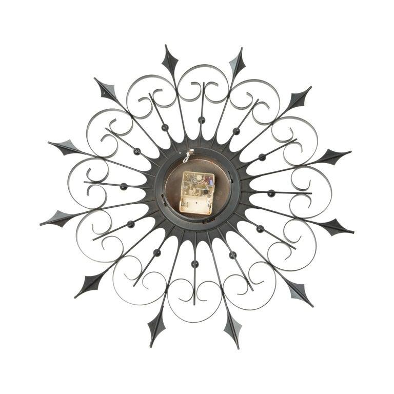 Welby Iron Sunburst Clock, circa 1950 In Good Condition In Los Angeles, CA