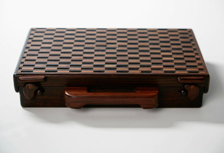 Exquisitely crafted slim decorative briefcase designed by Don Shoemaker for Señal of Mexico. Taking advantage of the expertise provided by Mexican artisans, shoemaker founded Señal which produced utilitarian objects, such as this stunning example.