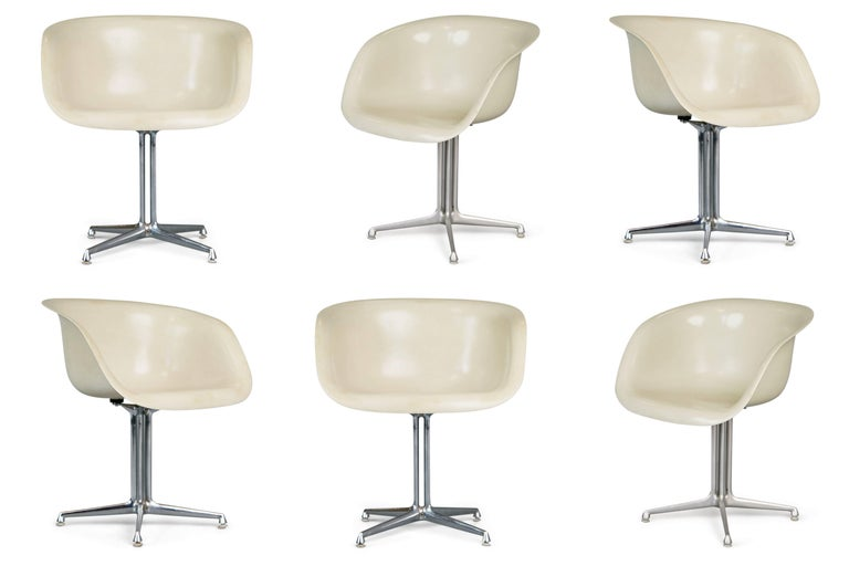In 1961 these armchairs were created in collaboration with Charles and Ray Eames when Alexander Girard was designing the interior of La Fonda Del Sol restaurant in New York City's Time Life Building. This assembled set of six chairs are comprised of
