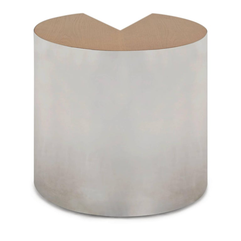 High quality and well-made chrome fronted circular shaped Pace side table with veneer wood cut-out shape, which provides a visually interesting contrast of materials and textures. This