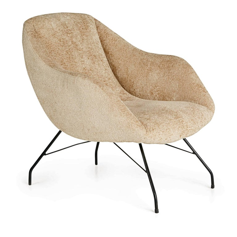Recently imported from a private collector in Brazil, this arm chair by Martin Eisler and Carlo Hauner for Forma, Brazil, encapsulates the quality and innovation of their designs. This elegant scoop chair with its slightly reclined back retains the