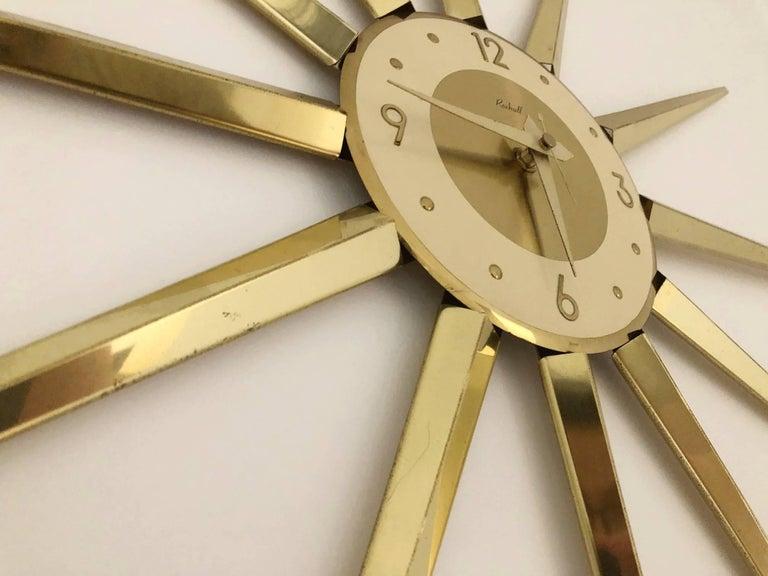 American Large Roxhall Brass Spike Sunburst Clock, circa 1960 For Sale